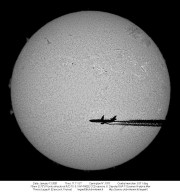 An Airplane in Front of the Sun