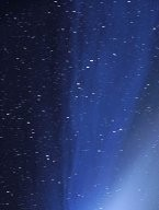 The Dust and Ion Tails of Comet Hale-Bopp