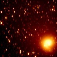 Hubble Sees Material Ejected from Comet Hale-Bopp