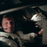 Apollo 11 Mission image - Spacecraft interior with astronaut Neil A. Armstrong looking at camera