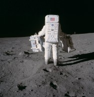 Apollo 11 Mission image - Astronaut Edwin Aldrin carries experiments to deployment area