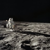 Apollo 12 Mission image - Astronaut Bean carries the ALSEP package to the deployment site