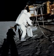 Apollo 12 Mission image - Alan Bean unloads ALSEP RTG from the LM