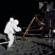 Apollo 12 Mission image - Alan Bean unloads ALSEP from the LM