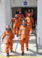 STS-125 Crew Members head for Launch Pad 39A