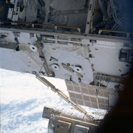 View of Bay 03 on the S0 truss and the Quest A/L taken STS-113