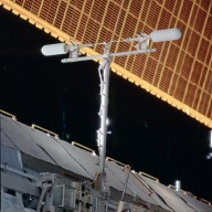 UHF antenna on P1 truss backdropped by a SAW taken during STS-113