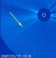 """Just like its """"cousin"""" nine days ago, yet another small comet appeared in the lower left area of the field of view of SOHO's C3 coronagraph instrument (February 14-15, 2007 and streaked right towards the Sun. This """"sungrazer"""" comet followed almost exactly the same trajectory as the comet observed on Feb. 6. They both most likely belonged to the Kreutz comet group. Kreutz comets are a family of comets that we often spot passing near the Sun. The members of the Kreutz group are believed to have all originated as part of the same parent comet that broke up in the past near perihelion (the closest approach to the Sun). In this case, due to a day long data gap in these images, we do not get to follow it into the Sun, but it is a fair assumption that it too was vaporized as it got too close. This comet is SOHO-1270 and was discovered by Hua Su (China) -- the third (almost second) most successful SOHO comet hunter with approx 140 comet finds! Some of you may not know that amateur comet hunters using the Internet have discovered about 75% of the SOHO comets."""