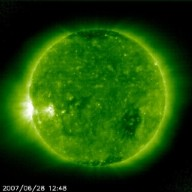 SOHO is keeping a close eye on a good-sized active region that is rotating into view. The video clip covers 36 hours (June 27-28, 2007) as the bright glow and arcs above the solar surface appear before we can actually see a sunspot on the surface of the Sun. The images were taken in extreme ultraviolet light at the 195 Angstrom wavelength. There have not been very many sunspots over the past year or so, so this one is generating some interest among solar observers. The sunspot that preceded it by a few days has generated some modest flares. Maybe this one will display even more firepower?