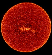 The Sun observed by SUMER on 12/13 May 1996 in the emission line of S VI at 933 A, formed in the transition region at about 200,000 K. The picture was put together from 9256 raster images with an exposure time of 3 s each, collected in eight alternating horizontal scans across the Sun.