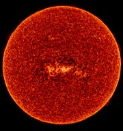 SUMER image in S VI at 933 Å on 1996 May 12. The Sun observed by SUMER in the emission line of S VI at 933 A, formed in the transition region at about 200,000 K. The picture was put together from 9256 raster images with an exposure time of 3 s each, collected in eight alternating horizontal scans across the Sun.