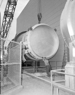 11 FOOT DIAMETER VALVE AT VARIOUS POSITIONS FOR ALTITUDE EXHAUST LINE IN REAR OF PROPULSION SYSTEMS LABORATORY PSL EQUIPMENT BUILDING - THIS VALVE MANUFACTURED BY W S ROCKWELL COMPANY