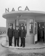 NACA LEWIS FLIGHT PROPULSION LABORATORY LFPL GUARDS IN THEIR NEW UNIFORMS STANDING IN FRONT OF GATE HOUSE