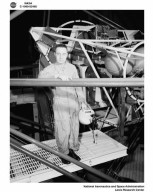 PROJECT MERCURY - ASTRONAUT CAPTAIN GUS GRISSOM IN THE ALTITUDE WIND TUNNEL AWT GIMBAL RIG