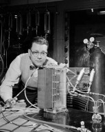 NEW EMPLOYEE ON THE JOB - ROBERT E POST - STUDYING CONSTRUCTION DETAILS OF A GENERAL ELECTRIC GE ION EXCHANGE MEMBRANE FUEL CELL - THIS IS ONE OF SEVERAL TYPES OF FUEL CELLS BEING STUDIED AT NASA LEWIS RESEARCH CENTER FOR SUITABILITY FOR USE IN THE