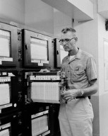 MAN AT WORK GENERAL DYNAMICS / ASTRONAUTICS GD/A IN SPACE POWER CHAMBER SPC - SEPARATION TEST CONTROL ROOM - H A ROUSE
