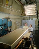 RESEARCH ENGINEER SUE JOHNSON AND MECHANIC IN SOLAR SIMULATOR CELL