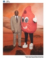 CENTER DIRECTOR DONALD CAMPBELL WITH BUDDY BLOOD DROP - THE AMERICAN RED CROSS BLODD DONATION MASCOT