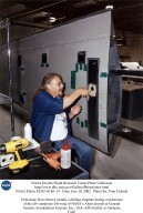 Technician Dave Brown installs a drilling template during construction of the all-composite left win