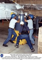 NASA Dryden technicians (Dave Dennis, Freddy Green and Jeff Doughty) position a support cylinder und