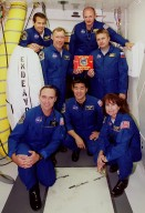 STS-108 and Expedition 4 pose outside Endeavour's hatch