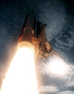 STS-73 Liftoff - Closeup view SSME and SRB after ignition