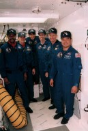 STS-72 Crew standing outside Endeavour at Launch Pad