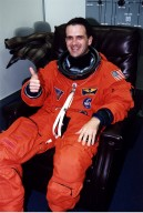 STS-81 Mission Specialist Peter Wisoff suits up