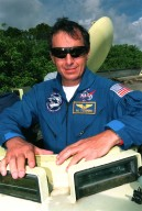STS-93 Mission Specialist Tognini takes part in emergency egress training