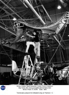 Technicians prepare the inflatable wing on Paresev 1-C