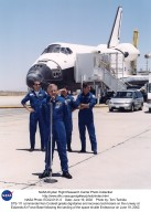 STS-111 commander, Ken Cockrell, greets dignitaries and recovery technicians on the runway at Edward