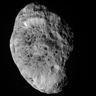 Saturn's Spongy Hyperion Tumbles Into View