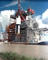 Saturn V First Stage Lifted into Test Stand.