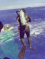 Navy Diver Leaps From Helicopter
