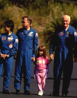 Members of the STS-95 crew and their families prepare for their return flight to the Johnson Space Center in Houston, Texas, at the Skid Strip at Cape Canaveral Air Station. The STS-95 mission ended with landing at Kennedy Space Center's Shuttle Landing Facility at 12:04 p.m. EST on Nov. 7. The STS-95 crew consists of Mission Commander Curtis L. Brown Jr.; Pilot Steven W. Lindsey; Mission Specialist Scott E. Parazynski; Mission Specialist Stephen K. Robinson; Mission Specialist Pedro Duque, with the European Space Agency (ESA); Payload Specialist Chiaki Mukai, with the National Space Development Agency of Japan (NASDA); and Payload Specialist John H. Glenn Jr., a senator from Ohio and one of the original seven Project Mercury astronauts. The mission included research payloads such as the Spartan-201 solar-observing deployable spacecraft, the Hubble Space Telescope Orbital Systems Test Platform, the International Extreme Ultraviolet Hitchhiker, as well as a SPACEHAB single module with experiments on space flight and the aging process