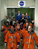 The STS-101 crew wave to onlookers as they leave the Operations and Checkout Building enroute to Launch Pad 39A for the fourth attempt at launch of Space Shuttle Atlantis. In their orange launch and entry suits, they are (front line, left to right) Pilot Scott J. Horowitz and Commander James D. Halsell Jr.; (second line) Mission Specialists Mary Ellen Weber (only her arm is visible) and Jeffrey N. Williams; and (third line) Mission Specialists Susan J. Helms, Yury Usachev of Russia and James S. Voss The mission will take the crew to the International Space Station to deliver logistics and supplies and to prepare the Station for the arrival of the Zvezda Service Module, expected to be launched by Russia in July 2000. Also, the crew will conduct one space walk and will reboost the space station from 230 statute miles to 250 statute miles. This will be the third assembly flight to the Space Station. Liftoff of Space Shuttle Atlantis for the 10-day mission is scheduled for about 6:12 a.m. EDT from Launch Pad 39A. Landing is targeted for May 29 at 2:19 a.m. EDT