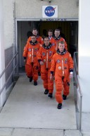The STS-97 crew leaves the O&C Building on their way to Launch Pad 39B for a simulated launch countdown. Commander Brent Jett (right) leads the way with Pilot Mike Bloomfield behind him. Taking up the rear are (left) Mission Specialists Carlos Noriega, Joe Tanner and (right) Marc Garneau, who is with the Canadian Space Agency. The crew is taking part in Terminal Countdown Demonstration Test activities that include emergency egress training, familiarization with the payload, and the simulated launch countdown. Mission STS-97is the sixth construction flight to the International Space Station. Its payload includes the P6 Integrated Truss Structure and a photovoltaic (PV) module, with giant solar arrays that will provide power to the Station. The mission includes two spacewalks to complete the solar array connections. STS-97 is scheduled to launch Nov. 30 at about 10:05 p.m. EST