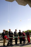 At the commissioning of a new high-pressure helium pipeline at Kennedy Space Center, participants cut the lines to helium-filled balloons. From left, they are Center Director Roy Bridges; Michael Butchko, president, SGS; Pierre Dufour, president and CEO, Air Liquide America Corporation; David Herst, director, Delta IV Launch Sites; Pamela Gillespie, executive administrator, office of Congressman Dave Weldon; and Col. Samuel Dick, representative of the 45th Space Wing. The nine-mile-long buried pipeline will service launch needs at the new Delta IV Complex 37 at Cape Canaveral Air Force Station. It will also serve as a backup helium resource for Shuttle launches. Nearly one launch?s worth of helium will be available in the pipeline to support a Shuttle pad in an emergency. The line originates at the Helium Facility on KSC and terminates in a meter station at the perimeter of the Delta IV launch pad. Others at the ceremony were Jerry Jorgensen, pipeline project manager, Space Gateway Support (SGS), and Ramon Lugo, acting executive director, JPMO