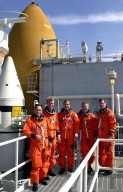 The STS-97 crew poses on the 215-foot level of the Fixed Service Structure during Terminal Countdown Demonstration Test activities that include emergency egress training, familiarization with the payload and a simulated launch countdown. From left, they are Mission Specialist Carlos Noriega, Commander Brent Jett, Pilot Mike Bloomfield, and Mission Specialists Marc Garneau and Joe Tanner. Mission STS-97 is the sixth construction flight to the International Space Station. Its payload includes the P6 Integrated Truss Structure and a photovoltaic (PV) module, with giant solar arrays that will provide power to the Station. The mission includes two spacewalks to complete the solar array connections. STS-97 is scheduled to launch Nov. 30 at 10:05 p.m. EST