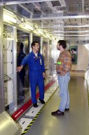 """KENNEDY SPACE CENTER, FLA. -- Astronaut John Herrington (left) shows a mockup of the U.S. Lab to Norm Abram, master carpenter of television?s """"This Old House"""" and """"The New Yankee Workshop."""" Abram is at KSC to film an episode of """"This Old House."""" The mockup lab is in the International Space Station Center, a tour facility"""