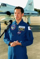 After their arrival at the Shuttle Landing Facility, the STS-99 crew talk to the media. At the microphone is Mission Specialist Mamoru Mohri, who is with the National Space Development Agency (NASDA) of Japan. The crew are here to take part in a Terminal Countdown Demonstration Test (TCDT), which provides simulated countdown exercises, emergency egress training, and opportunities to inspect the mission payloads in the orbiter's payload bay. Others taking part in the TCDT are Commander Kevin Kregel, Pilot Dominic Gorie and Mission Specialists Janice Voss (Ph.D.), Janet Lynn Kavandi (Ph.D.), and Gerhard Thiele, with the European Space Agency. STS-99 is the Shuttle Radar Topography Mission, which will chart a new course, using two antennae and a 200-foot-long section of space station-derived mast protruding from the payload bay to produce unrivaled 3-D images of the Earth's surface. The result of the Shuttle Radar Topography Mission could be close to 1 trillion measurements of the Earth's topography. Besides contributing to the production of better maps, these measurements could lead to improved water drainage modeling, more realistic flight simulators, better locations for cell phone towers, and enhanced navigation safety. Launch of Endeavour on the 11-day mission is scheduled for Jan. 31 at 12:47 p.m. EST