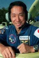 STS-99 Mission Specialist Mamoru Mohri, who is with the National Space Development Agency (NASDA) of Japan, smiles during training on the M-113, an armored personnel carrier that is part of emergency egress training during Terminal Countdown Demonstration Test (TCDT) activities. The tracked vehicle could be used by the crew in the event of an emergency at the pad during which the crew must make a quick exit from the area. TCDT provides the crew with simulated countdown exercises, emergency egress training, and opportunities to inspect the mission payloads in the orbiter's payload bay. STS-99 is the Shuttle Radar Topography Mission, which will chart a new course, using two antennae and a 200-foot-long section of space station-derived mast protruding from the payload bay to produce unrivaled 3-D images of the Earth's surface. The result of the Shuttle Radar Topography Mission could be close to 1 trillion measurements of the Earth's topography. Besides contributing to the production of better maps, these measurements could lead to improved water drainage modeling, more realistic flight simulators, better locations for cell phone towers, and enhanced navigation safety. Launch of Endeavour on the 11-day mission is scheduled for Jan. 31 at 12:47 p.m. EST