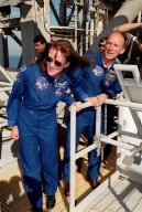 KENNEDY SPACE CENTER, Fla. -- On the Fixed Service Structure at Launch Pad 39A, STS-99 Mission Specialists Janet Lynn Kavandi (Ph.D.) and Gerhard Thiele, who is with the European Space Agency, look over the emergency egress equipment. The crew are taking part in Terminal Countdown Demonstration Test activities, which provide them with simulated countdown exercises, emergency egress training, and opportunities to inspect the mission payloads in the orbiter's payload bay. STS-99 is the Shuttle Radar Topography Mission, which will chart a new course, using two antennae and a 200-foot-long section of space station-derived mast protruding from the payload bay to produce unrivaled 3-D images of the Earth's surface. The result of the Shuttle Radar Topography Mission could be close to 1 trillion measurements of the Earth's topography. Besides contributing to the production of better maps, these measurements could lead to improved water drainage modeling, more realistic flight simulators, better locations for cell phone towers, and enhanced navigation safety. Launch of Endeavour on the 11-day mission is scheduled for Jan. 31 at 12:47 p.m. EST