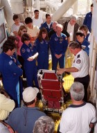 At Launch Pad 39A, members of the STS-99 crew and others look over part of the safety equipment. Standing left to right (in uniform) are Commander Kevin Kregel, Pilot Dominic Gorie, and Mission Specialists Janice Voss (Ph.D.), Janet Lynn Kavandi (Ph.D.), Gerhard Thiele and Mamoru Mohri. Thiele is with the European Space Agency and Mohri is with the National Space Development Agency (NASDA) of Japan. The crew are taking part in Terminal Countdown Demonstration Test activities, which provide them with simulated countdown exercises, emergency egress training, and opportunities to inspect the mission payloads in the orbiter's payload bay. STS-99 is the Shuttle Radar Topography Mission, which will chart a new course, using two antennae and a 200-foot-long section of space station-derived mast protruding from the payload bay to produce unrivaled 3-D images of the Earth's surface. The result of the Shuttle Radar Topography Mission could be close to 1 trillion measurements of the Earth's topography. Besides contributing to the production of better maps, these measurements could lead to improved water drainage modeling, more realistic flight simulators, better locations for cell phone towers, and enhanced navigation safety. Launch of Endeavour on the 11-day mission is scheduled for Jan. 31 at 12:47 p.m. EST