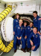 Inside the White Room attached to the Fixed Service Structure on Launch Pad 39A, the STS-99 crew pose at the entrance to the orbiter Endeavour. From left are Mission Specialists Janet Lynn Kavandi (Ph.D.), Gerhard Thiele, Janice Voss (Ph.D.) and Mamoru Mohri, Commander Kevin Kregel (standing) and Pilot Dominic Gorie (kneeling in front). Thiele is with the European Space Agency and Mohri is with the National Space Development Agency (NASDA) of Japan. The crew are taking part in Terminal Countdown Demonstration Test activities, which provide them with simulated countdown exercises, emergency egress training, and opportunities to inspect the mission payloads in the orbiter's payload bay. STS-99 is the Shuttle Radar Topography Mission, which will chart a new course, using two antennae and a 200-foot-long section of space station-derived mast protruding from the payload bay to produce unrivaled 3-D images of the Earth's surface. The result of the Shuttle Radar Topography Mission could be close to 1 trillion measurements of the Earth's topography. Besides contributing to the production of better maps, these measurements could lead to improved water drainage modeling, more realistic flight simulators, better locations for cell phone towers, and enhanced navigation safety. Launch of Endeavour on the 11-day mission is scheduled for Jan. 31 at 12:47 p.m. EST