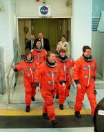 The STS-99 crew leave the Operations and Checkout Building on their way to Launch Pad 39A and a simulated countdown exercise. In the front row are Pilot Dominic Gorie and Commander Kevin Kregel; in the middle row are mission Specialists Janice Voss (Ph.D.) and Janet Lynn Kavandi (Ph.D.); in the back row are Mission Specialists Mamoru Mohri, who is with the National Space Development Agency (NASDA) of Japan, and Gerhard Thiele, who is with the European Space Agency. The crew are taking part in Terminal Countdown Demonstration Test activities, which provide them with simulated countdown exercises, emergency egress training, and opportunities to inspect the mission payloads in the orbiter's payload bay. STS-99 is the Shuttle Radar Topography Mission, which will chart a new course, using two antennae and a 200-foot-long section of space station-derived mast protruding from the payload bay to produce unrivaled 3-D images of the Earth's surface. The result of the Shuttle Radar Topography Mission could be close to 1 trillion measurements of the Earth's topography. Besides contributing to the production of better maps, these measurements could lead to improved water drainage modeling, more realistic flight simulators, better locations for cell phone towers, and enhanced navigation safety. Launch of Endeavour on the 11-day mission is scheduled for Jan. 31 at 12:47 p.m. EST