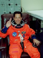 In the Operations and Checkout Building, STS-99 Mission Specialist Mamoru Mohri (Ph.D.), who is with the National Space Development Agency (NASDA) of Japan, waves as he waits for final suitup preparations before launch. Liftoff of STS-99, known as the Shuttle Radar Topography Mission, is scheduled for 12:47 p.m. EST from Launch Pad 39A. The SRTM will chart a new course to produce unrivaled 3-D images of the Earth's surface, using two antennae and a 200-foot-long section of space station-derived mast protruding from the payload bay. The result of the Shuttle Radar Topography Mission could be close to 1 trillion measurements of the Earth's topography. Besides contributing to the production of better maps, these measurements could lead to improved water drainage modeling, more realistic flight simulators, better locations for cell phone towers, and enhanced navigation safety. The mission is expected to last about 11days, with Endeavour landing at KSC Friday, Feb. 11, at 4:55 p.m. EST