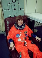 In the Operations and Checkout Building, STS-99 Mission Specialist Janice Voss (Ph.D.) smiles as she dons her launch and entry suit during final launch preparations. Liftoff of STS-99, known as the Shuttle Radar Topography Mission (SRTM), is scheduled for 12:47 p.m. EST from Launch Pad 39A. The SRTM will chart a new course to produce unrivaled 3-D images of the Earth's surface, using two antennae and a 200-foot-long section of space station-derived mast protruding from the payload bay. The result of the Shuttle Radar Topography Mission could be close to 1 trillion measurements of the Earth's topography. Besides contributing to the production of better maps, these measurements could lead to improved water drainage modeling, more realistic flight simulators, better locations for cell phone towers, and enhanced navigation safety. The mission is expected to last about 11days. Endeavour is expected to land at KSC Friday, Feb. 11, at 4:55 p.m. EST