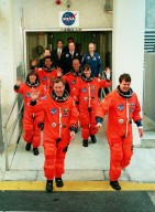 The STS-99 crew wave to onlookers as they leave the Operations and Checkout Building enroute to Launch Pad 39A and liftoff of Space Shuttle Endeavour, targeted for 12:47 p.m. EST. In their orange launch and entry suits, they are (foreground) Pilot Dominic Gorie and Commander Kevin Kregel. Behind them (left to right) are Mission Specialists Janice Voss (Ph.D.), Mamoru Mohri (Ph.D.), Gerhard Thiele and Janet Lynn Kavandi (Ph.D.). Mohri is with the National Space Development Agency (NASDA) of Japan, and Thiele is with the European Space Agency. The SRTM will chart a new course to produce unrivaled 3-D images of the Earth's surface, using two antennae and a 200-foot-long section of space station-derived mast protruding from the payload bay. The result of the Shuttle Radar Topography Mission could be close to 1 trillion measurements of the Earth's topography. Besides contributing to the production of better maps, these measurements could lead to improved water drainage modeling, more realistic flight simulators, better locations for cell phone towers, and enhanced navigation safety. The mission is expected to last about 11days, with Endeavour landing at KSC Friday, Feb. 11, at 4:55 p.m. EST