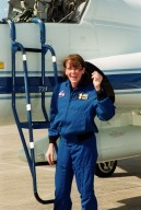 STS-99 Mission Specialist Janet Lynn Kavandi (Ph.D.) looks surprised and happy after landing at KSC aboard a T-38 jet aircraft to prepare for launch of Endeavour Jan. 31 at 12:47 p.m. EST. Over the next few days, the crew will review mission procedures, conduct test flights in the Shuttle Training Aircraft and undergo routine preflight medical exams. STS-99 is the Shuttle Radar Topography Mission, which will chart a new course, using two antennae and a 200-foot-long section of space station-derived mast protruding from the payload bay to produce unrivaled 3-D images of the Earth's surface. The result of the Shuttle Radar Topography Mission could be close to 1 trillion measurements of the Earth's topography. Besides contributing to the production of better maps, these measurements could lead to improved water drainage modeling, more realistic flight simulators, better locations for cell phone towers, and enhanced navigation safet